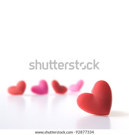 Studio image of five Valentine hearts with focus on the foreground. Isolated on white. 21 x 21 cm crop. Copy space.