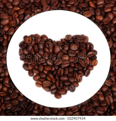 Studio image of heart shaped dark brown coffee beans/Coffee beans