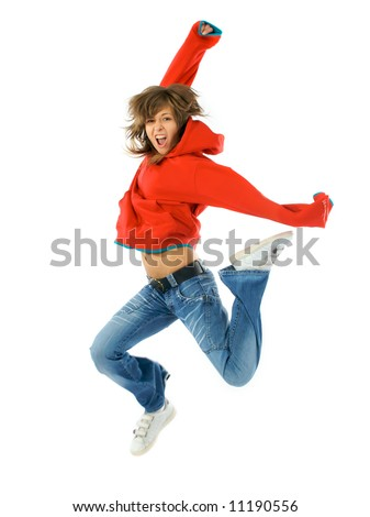Studio isolated. Dancing woman in red with brown long hair and happy smiling facial expression jumping up.