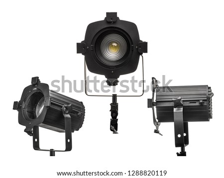 Studio lamp or stage light spotlight.  COB LED spot with Fresnel lens used for studio, theatre and concert lighting. Isolated on 255 white background. #1288820119