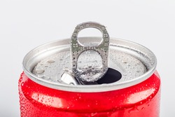 Studio lighting. aluminum red can with small drops of water on it. Chilled. The cover is open. On white background