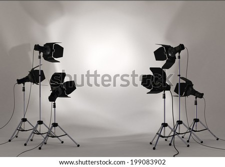 Studio lighting equipment with copy space of your image or message in a spotlight on white wall environment #199083902