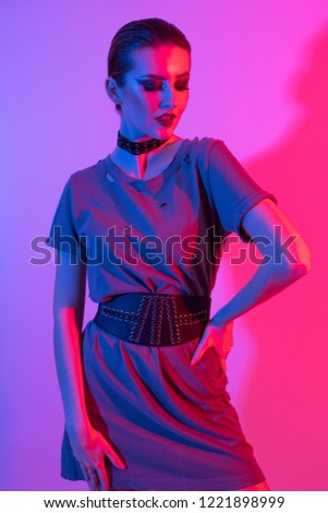 Studio lighting technique, coloured gel lighting with alternative edgy model. UK