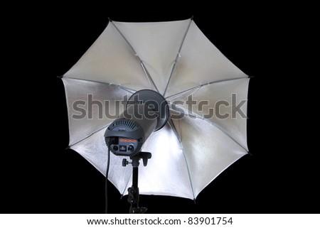 studio lights umbrella isolated on black