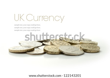 Studio macro image of UK currency coins with soft shadows against a white background. Copy space.