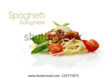 Studio macro of Spaghetti Bolognese meal with basil leaves, grated parmesan cheese and tomatoes. Copy space.