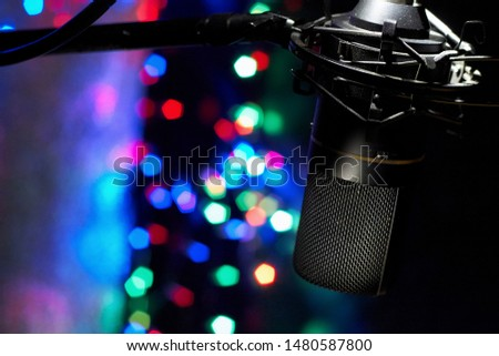 Studio Microphone at a night party. Party bokeh beauty, preparing for the holiday, Audio equipment