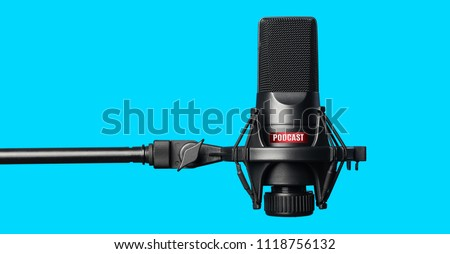 Studio microphone for recording podcasts over blue background Foto stock ©