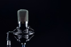 Studio microphone recording studio industry translation. Microphone on black background.
