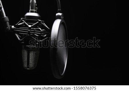 Studio microphone with pop filter with dramatic light. Concept. Leading radio, bloggers, singers, track recording, voice acting. Stok fotoğraf ©
