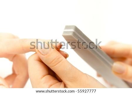 Studio nail - beautician polishing nails