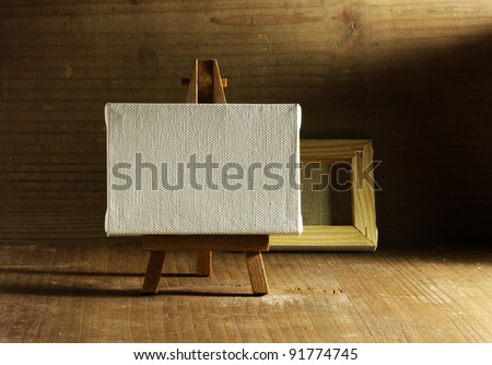 studio painter with easel and canvas, old wood