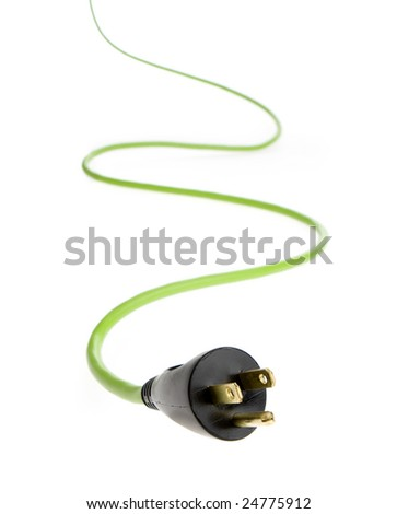 Studio photo of bright green electrical cable with plug in foreground.