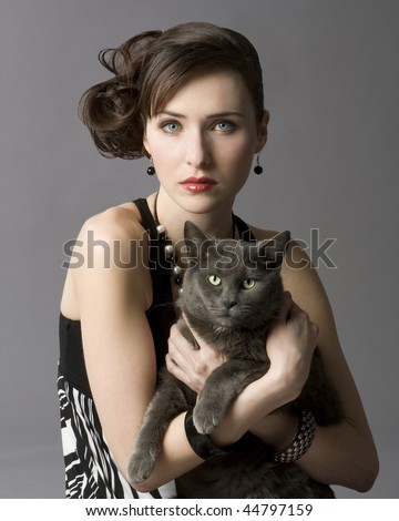 http://image.shutterstock.com/display_pic_with_logo/73989/73989,1263869383,1/stock-photo-studio-photo-of-elegant-young-woman-holding-gray-cat-44797159.jpg