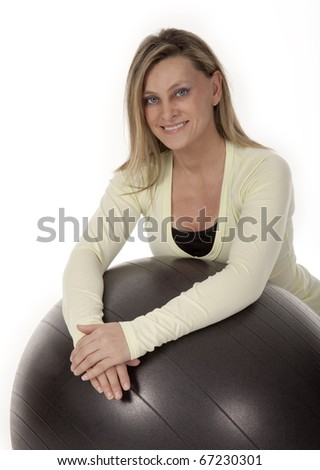 Studio photo of female fitness instructor on white background.