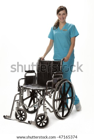Studio photo of female healthcare worker standing beside wheelchair. White background.