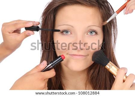 Studio photo of make-up process over white background