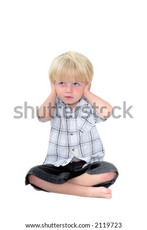 Studio photo of young boy with his hands over his ears and white isolated background