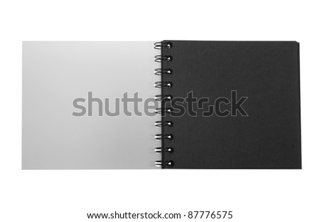 studio photography of a dark booklet with spiral binding isolated on white, with clipping path