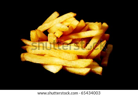 Studio photography of a roasted potatoes french fried chips isolated on black background