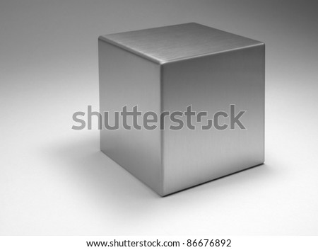 studio photography of a solid metal cube in light back