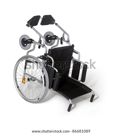 studio photography  of a turn over wheelchair in white back with shadow