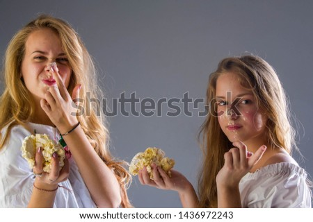 studio photography, portrait of girls 14 years old, girls playing in the studio with cake