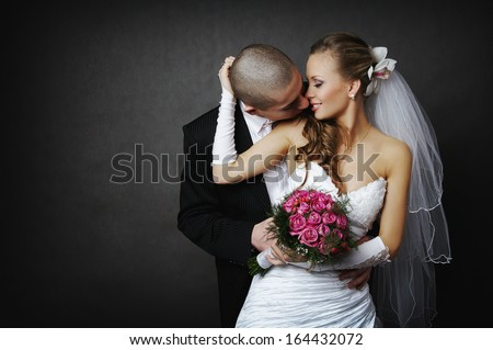 Studio Photography Studio Using One Lamp Illuminating A Happy Young Couple, A Man And A Woman