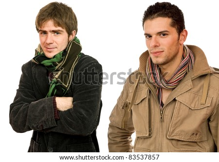 studio picture of two young men dressed for winter - stock photo