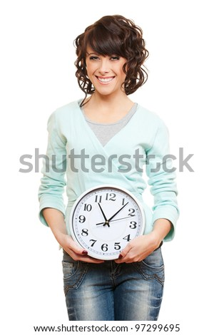 studio picture of young smiley woman with clock over white background
