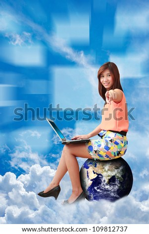 Studio portrait lady on globe on the cloud : Elements of this image furnished by NASA
