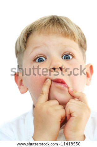 Studio portrait of a cute five year old boy making funny faces on white background