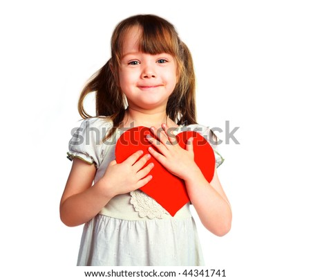 studio portrait of a cute little girl with  a Valentine card in her hands