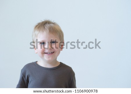 Studio portrait of a cute smiling boy. Happy child. #1106900978