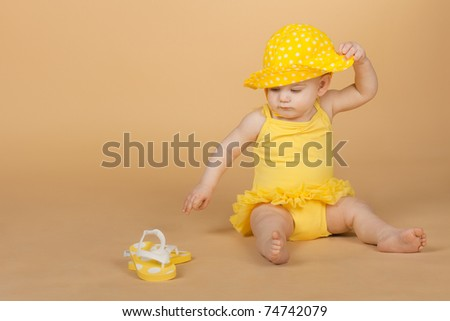 Studio portrait of a girl in a bright yellow dress