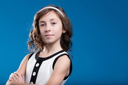 studio portrait of a girl on a blue background