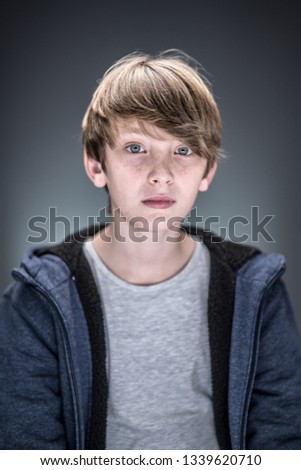 Studio portrait of a handsome and expressive young caucasian boy #1339620710