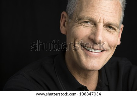 Studio Portrait of a handsome man with grey hair looking to the camera #108847034