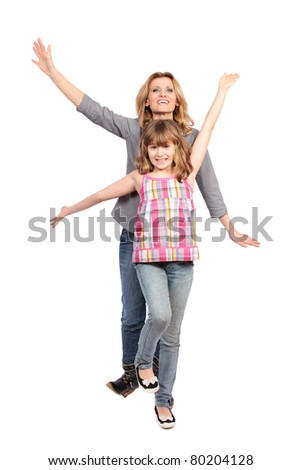 Studio portrait of a happy mother and daughter isolated on white background