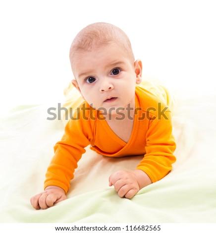 Studio portrait of a newborn caucasian boy sitting on his tummy