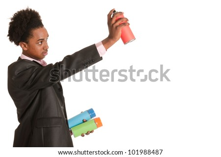 Studio portrait of a young African American man with graffiti aerosols