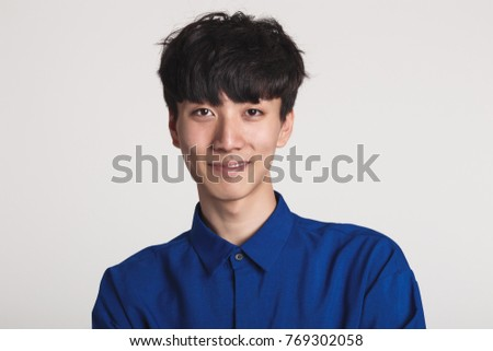 Studio portrait of an asian man smiling confident and happy