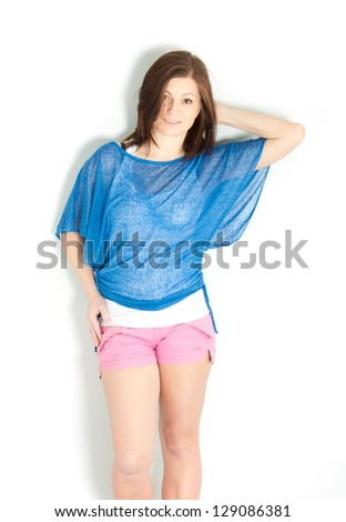 Studio portrait of an attractive young woman over white background. - stock photo