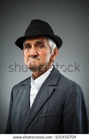 Studio portrait of an expressive old man