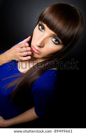 Studio portrait of attractive woman model blowing a kiss at the camera
