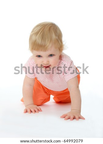 Studio portrait of baby running on all fours