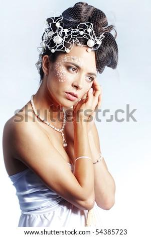 Studio portrait of beautiful stylish bride