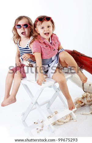 Studio portrait of children sea theme