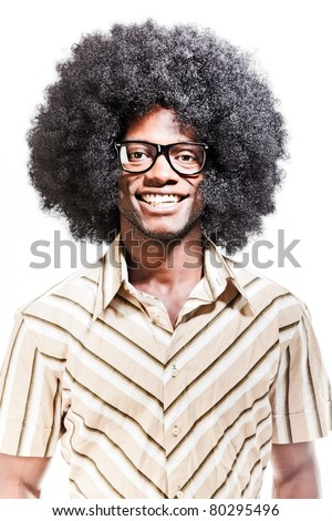 Studio portrait of cool black young man with black glasses, striped retro 70s shirt and retro afro hair isolated on white background.