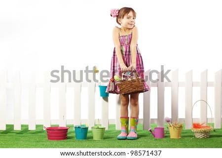 Studio portrait of cute kid girl Easter series